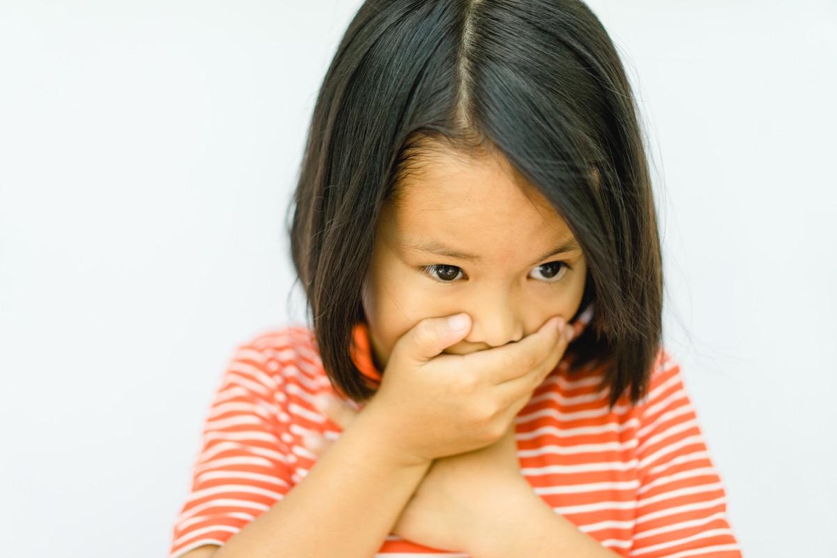 little girl covering mouth, school nurse secrets
