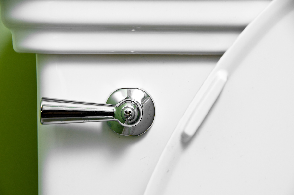 Close-up of steel toilet handle