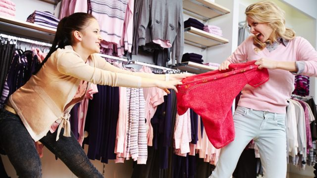two women fight over an item while shopping in a nightmare experience