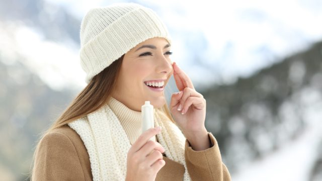 Woman Putting on Sunscreen in the Winter {Wear Sunscreen}