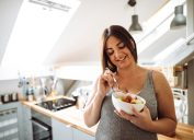 pregnant woman eating healthy food at home