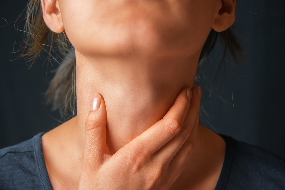 Woman Touching Her Neck in Pain unexpected signs your heart is unhealthy