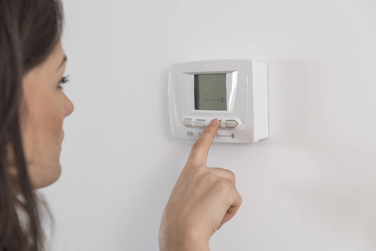Woman Setting a Thermostat Weight Loss Advice
