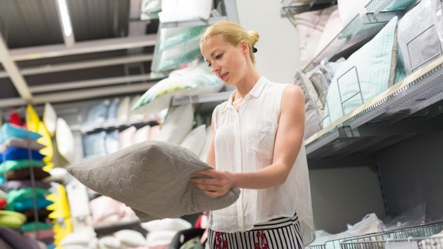 Woman shopping for bedding