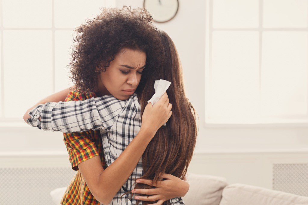 Women Hugging and Crying {Benefits of Crying}
