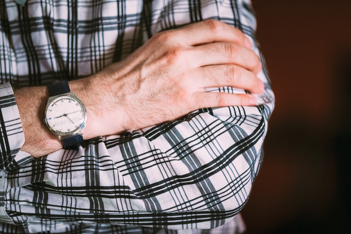 Man wearing an old watch