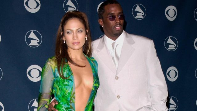 jennifer lopez in her iconic versace dress alongside sean puffy combs on the grammys red carpet in 2000