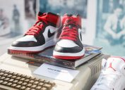 MOSCOW-6 AUGUST, 2016:Rare Nike Air Force 1 basketball sneakers in black, white & red colors.Nike basketball fashion shoes on stand at fashion exposition.Fashionable foot wear for youth & Apple II pc - Image