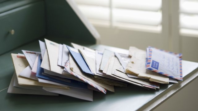 Pile of Mail on a Desk {Secrets Your Mailman Knows}