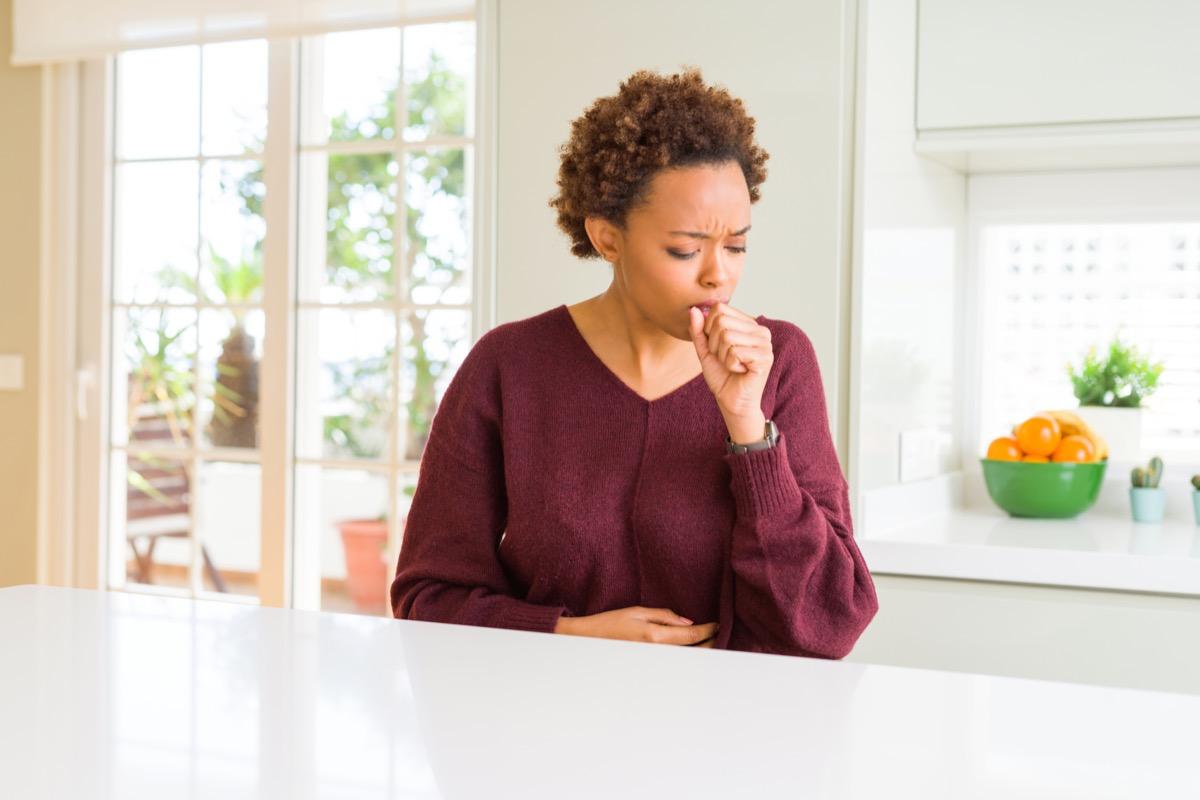 40-something black woman coughing