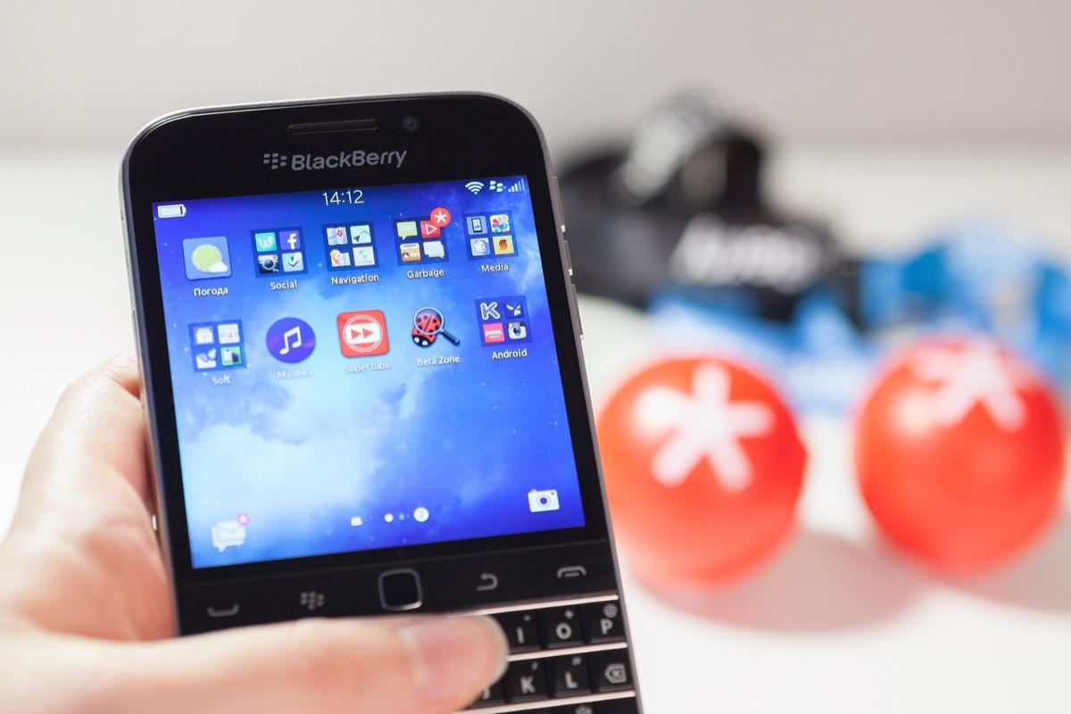 blackberry phone in someone's hands, original brand names