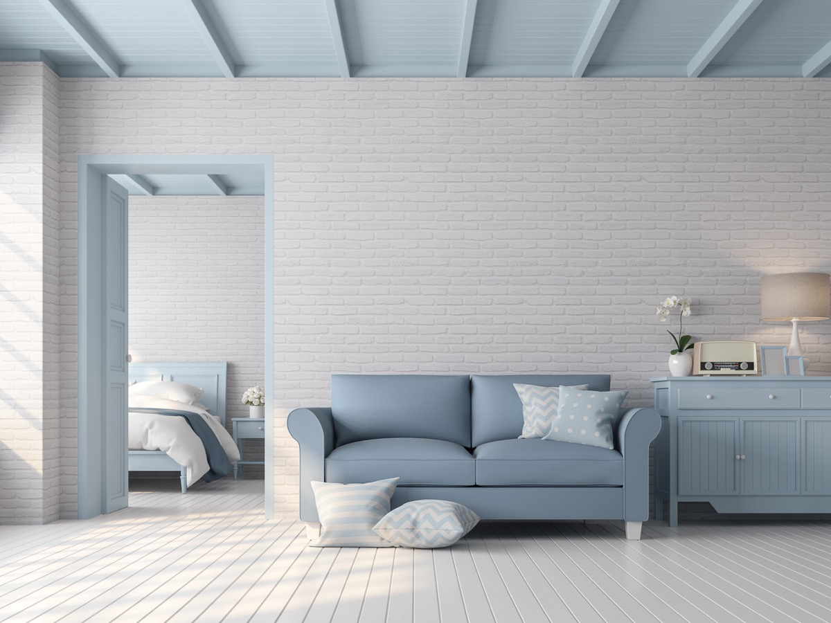 Blue accented room with exposed brick