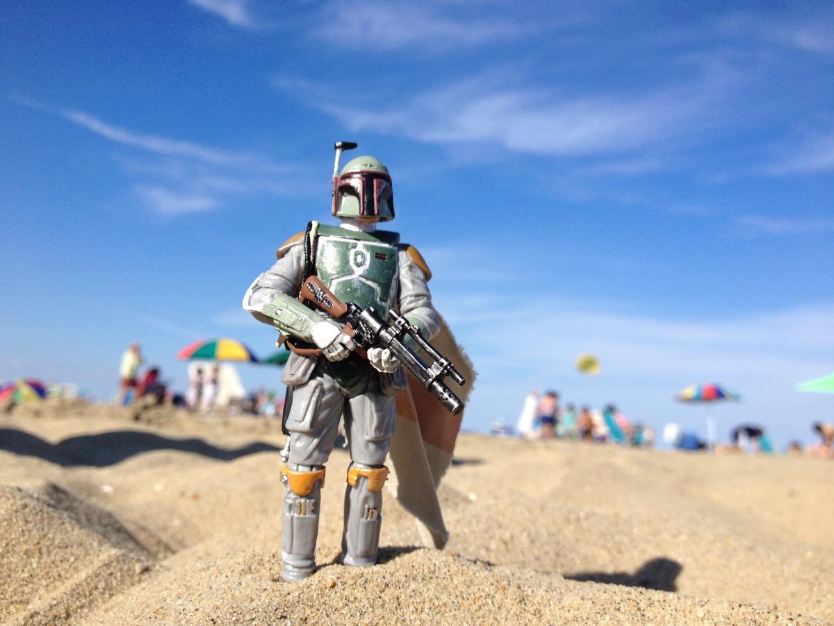AVON, NEW JERSEY: AUGUST 15, 2013: Star Wars figure of Boba Fett on a beach. - Image