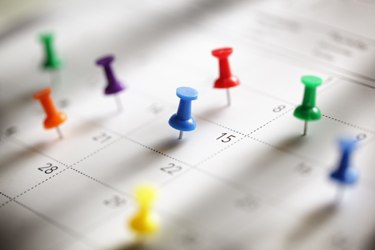 Calendar with thumbtacks in it