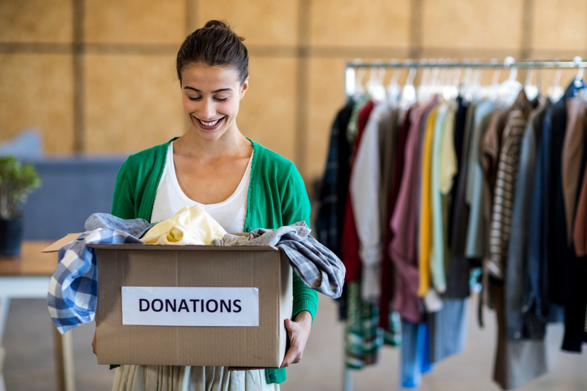 Woman Donating a Box of Clothes {Smart Shopping Habits}