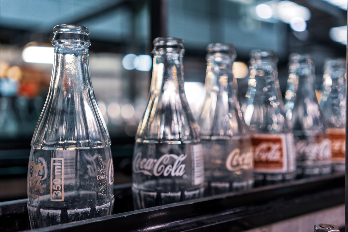 coca cola factory, ready-to-fill bottles on the line