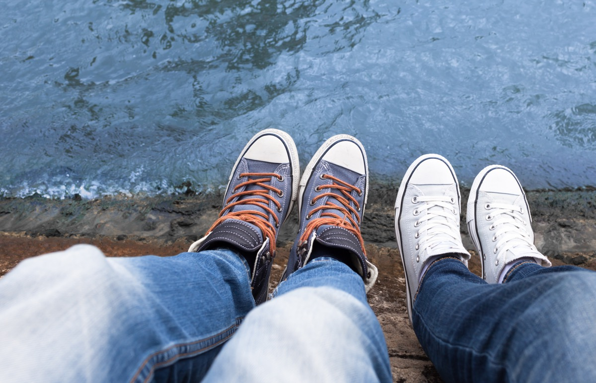 couple wearing converse low top shoes