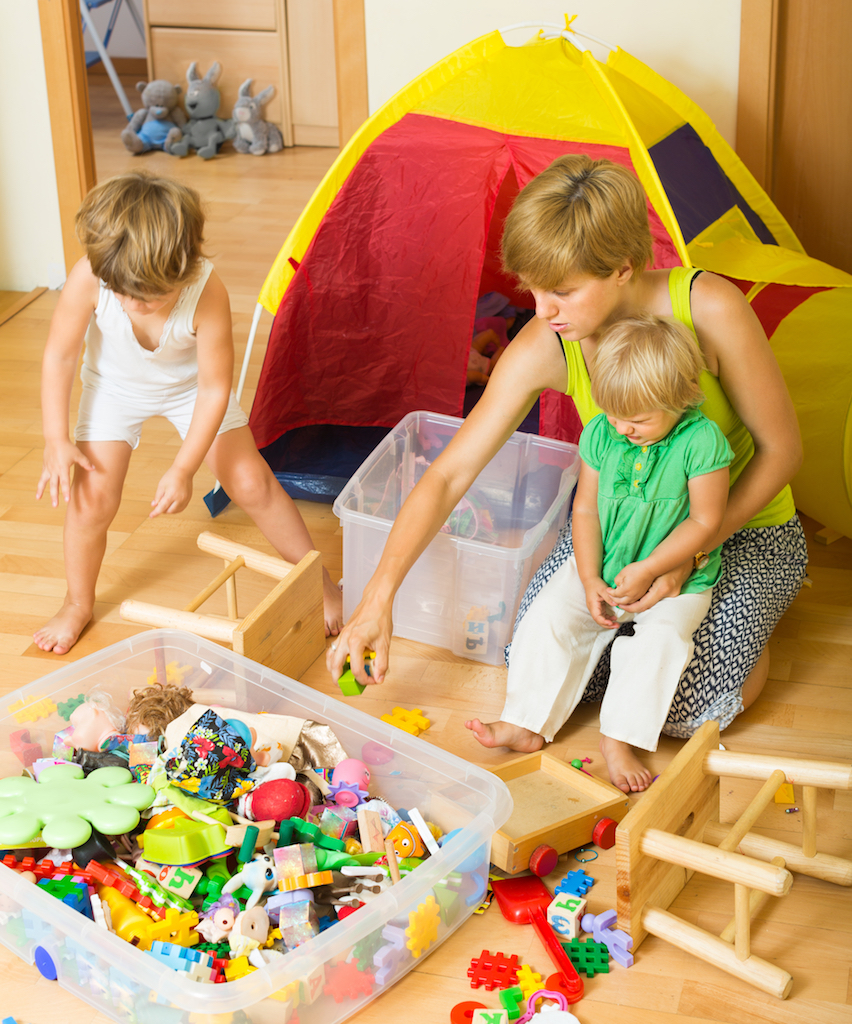 Family Using Storage Containers Tricks for hiding children's toys