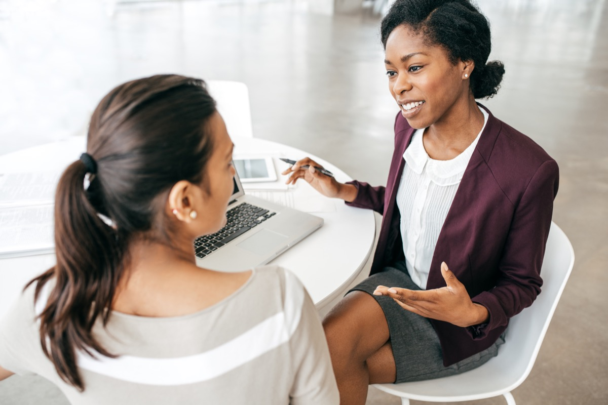 female boss and female employee discussing work together