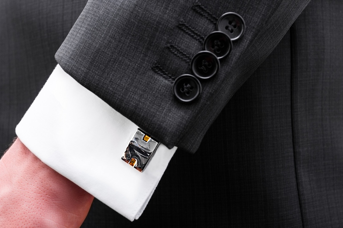 french cuff white shirt sleeves on a suit jacket
