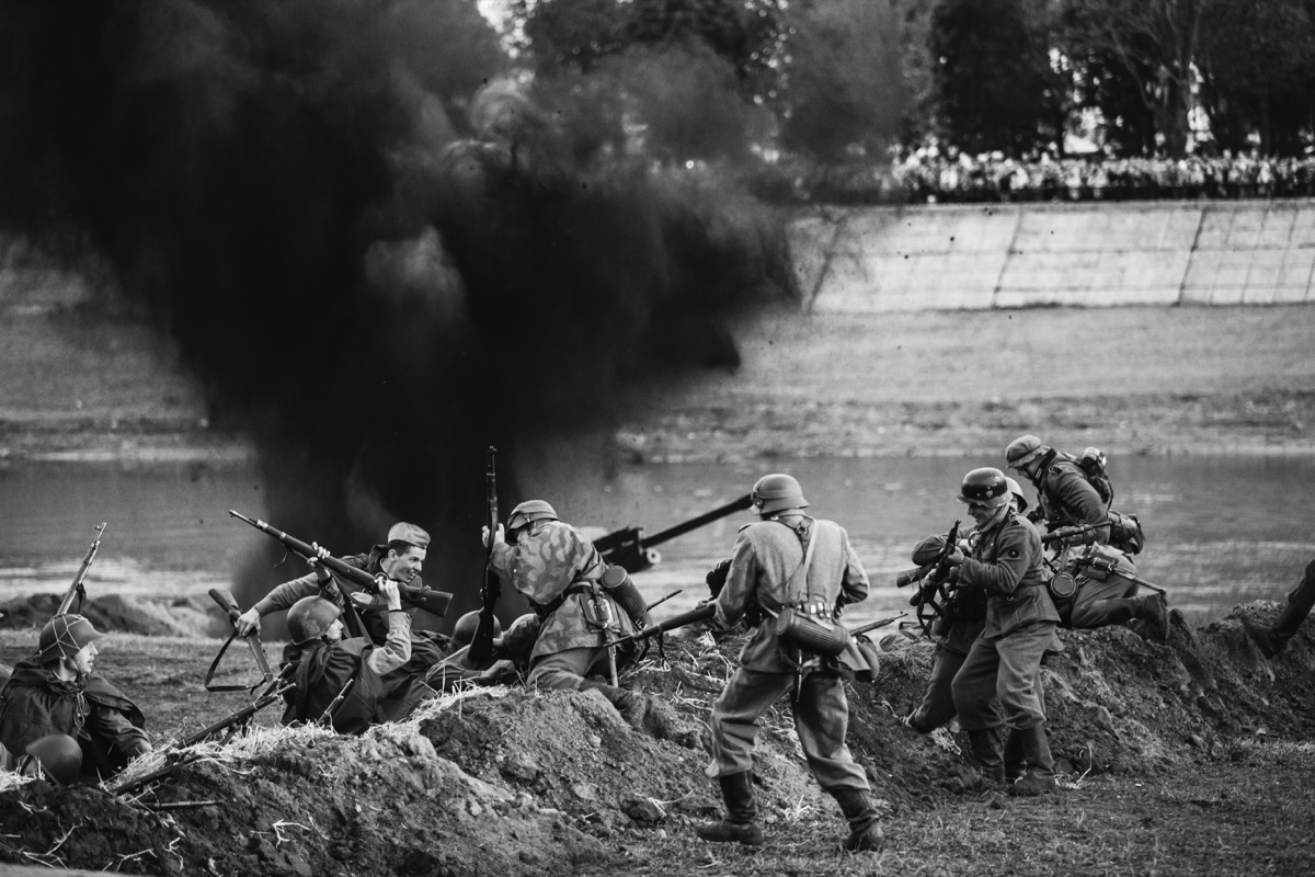 Re-enactors Dressed As German Wehrmacht Infantry Soldiers And Russian Soviet Red Army Soldiers World War II Play A Melee Scene About Fighting In Trenches