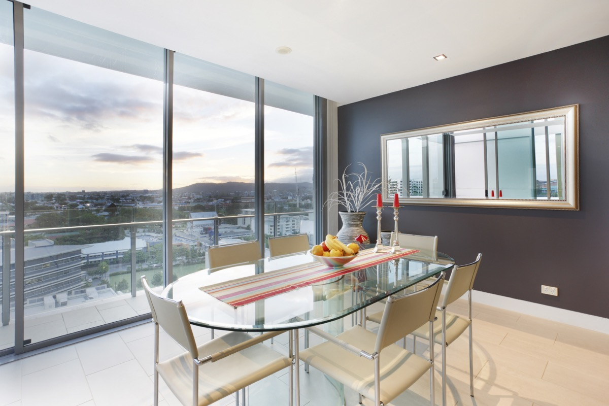 Glass kitchen table with full length window view
