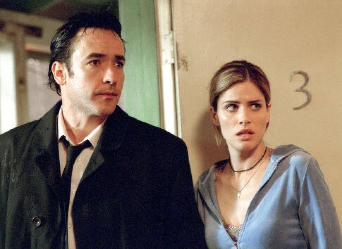 John Cusack and Amanda Peet in Identity (2003)