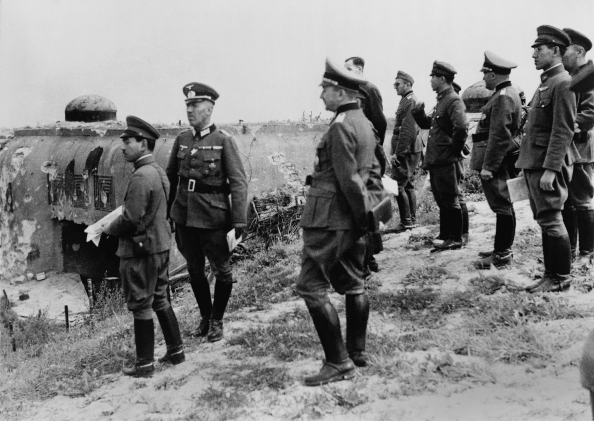 Japanese officers inspect Maginot Line, after the German defeat of France in World War 2. They inspect the damaged entrance to the elaborate fortifications at Schoenenbourg. Sept. 26, 1940