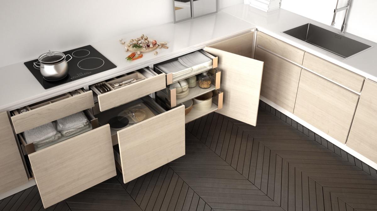 Modern kitchen top view, opened wooden drawers with accessories inside, solution for kitchen storage, minimalist interior design