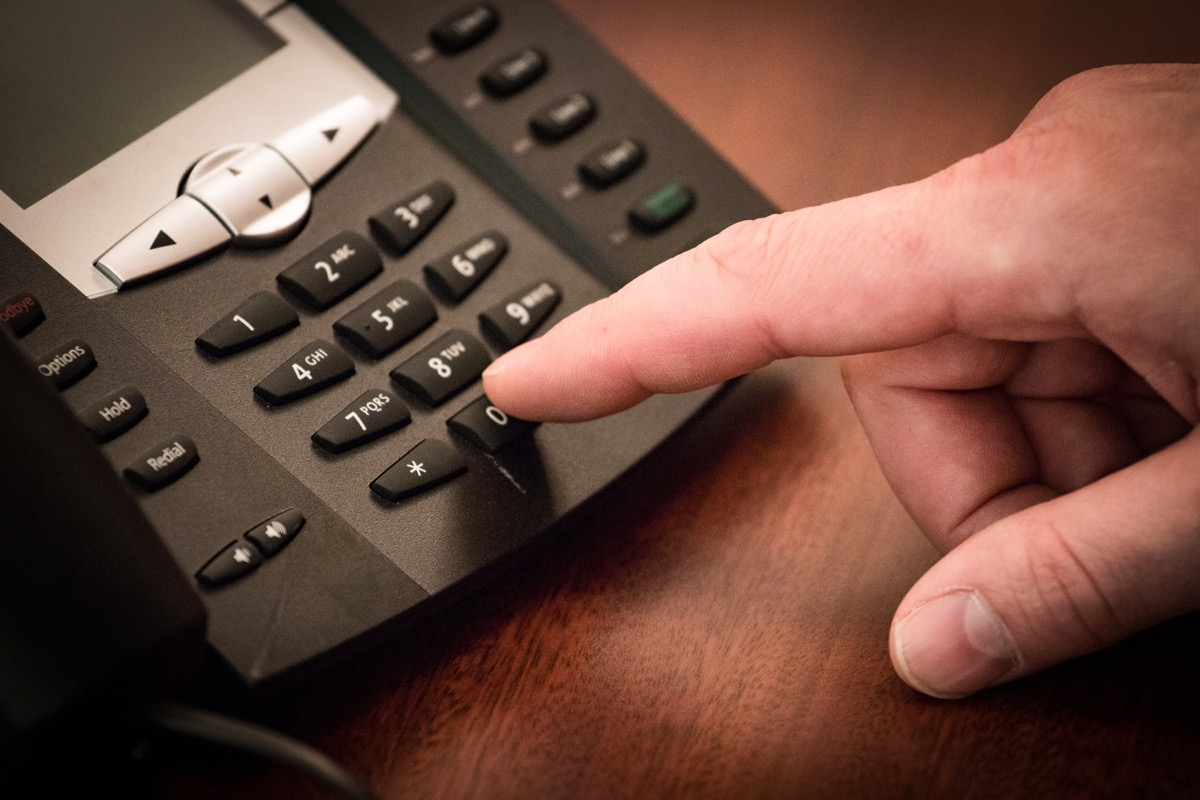 Person Using a Phone to Leave a Voicemail {New Words}