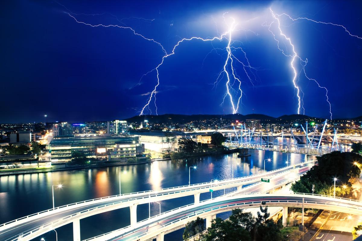 a striking image of lightning strikers over brisbane australia