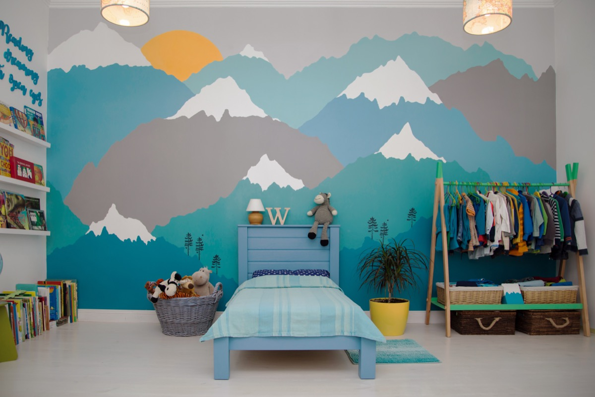 Little boy's bedroom with a mountain mural