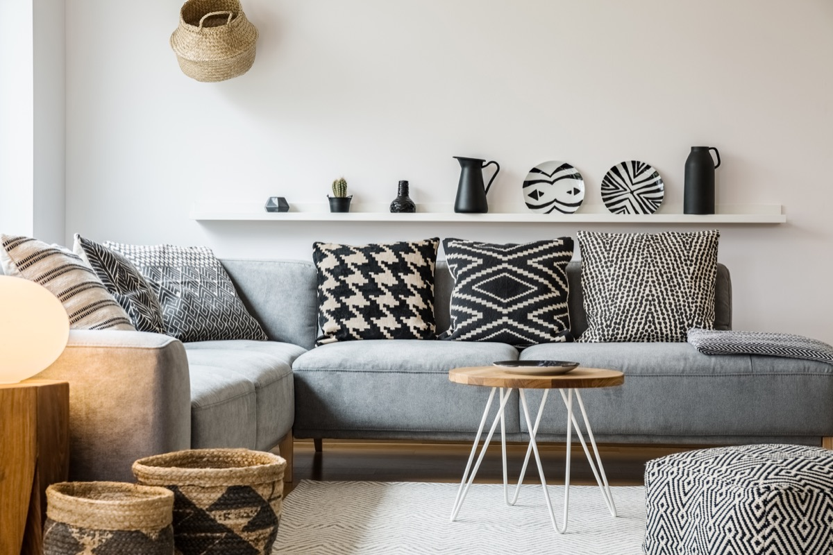 Black white and gray accented living room decor plates as art