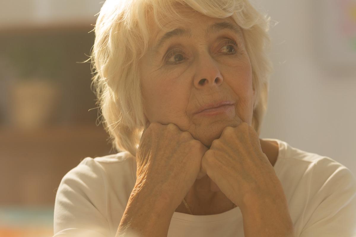 Lonely older woman pondering