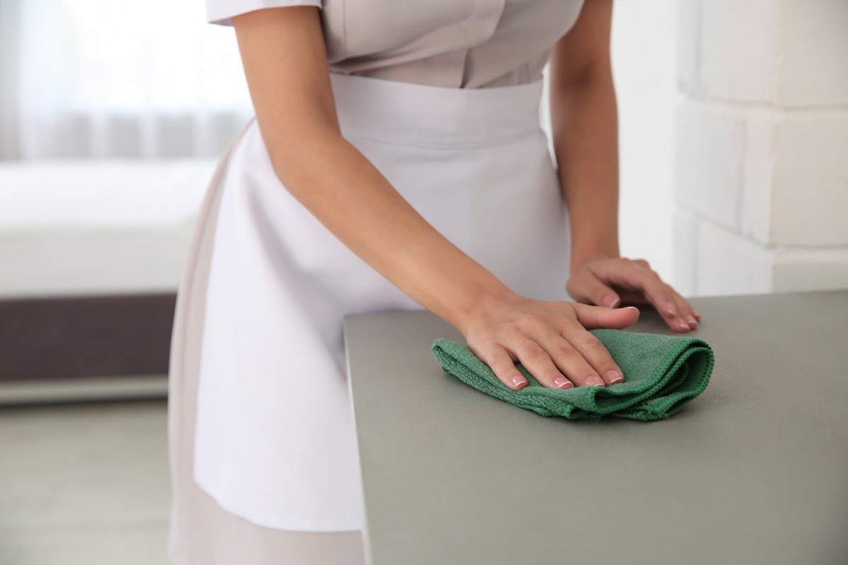 Maid Cleaning the Kitchen Counter {Risks You Should Take}