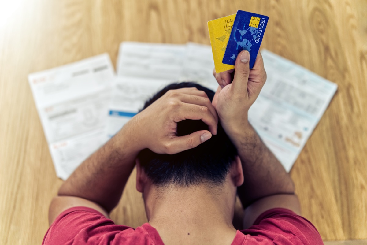 Man stressing over his bills and credit cards
