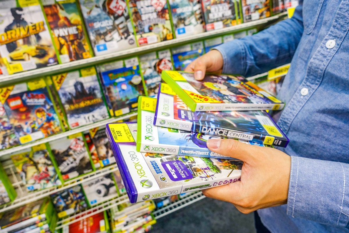 Man shopping for video games at the store