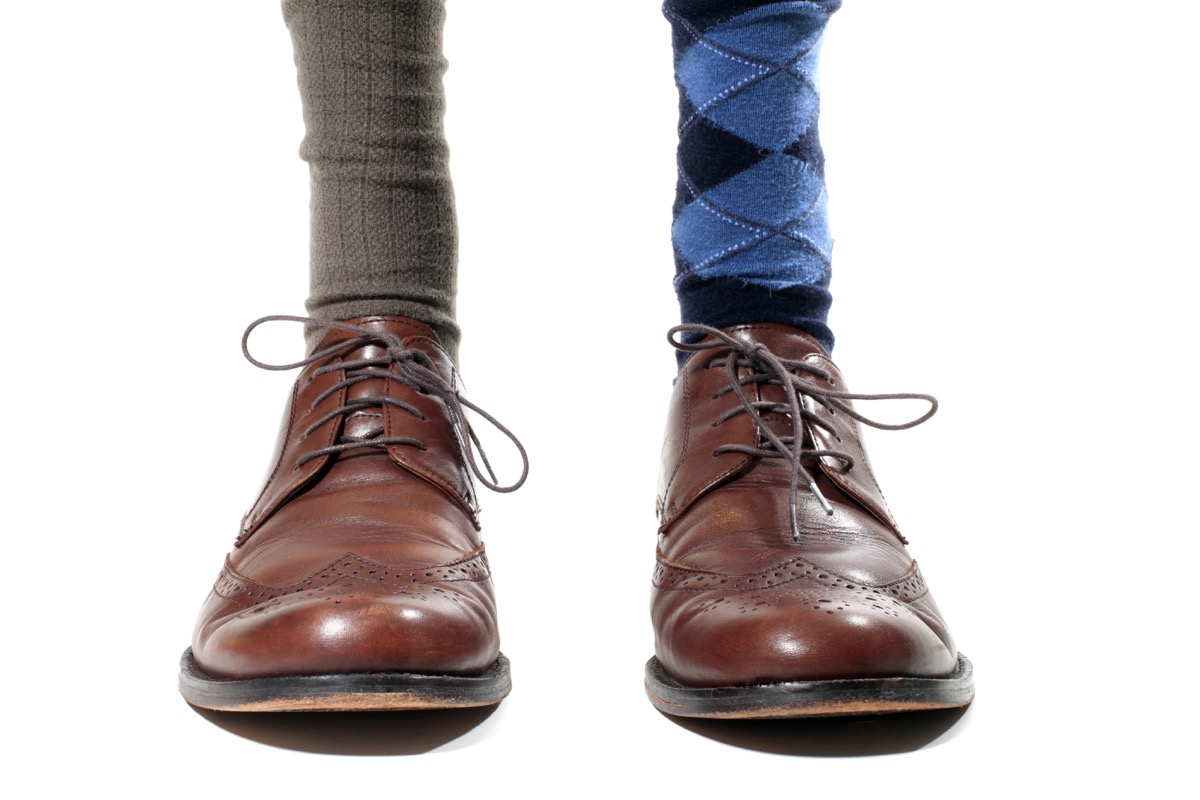 Man wearing mismatched socks with business shoes