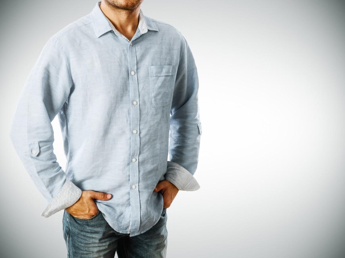 man wearing an untucked dress shirt
