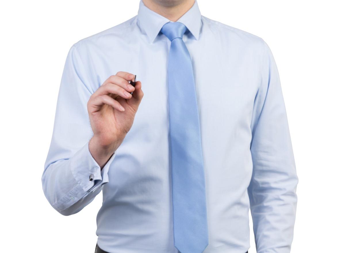 man wearing light blue shirt and light blue tie