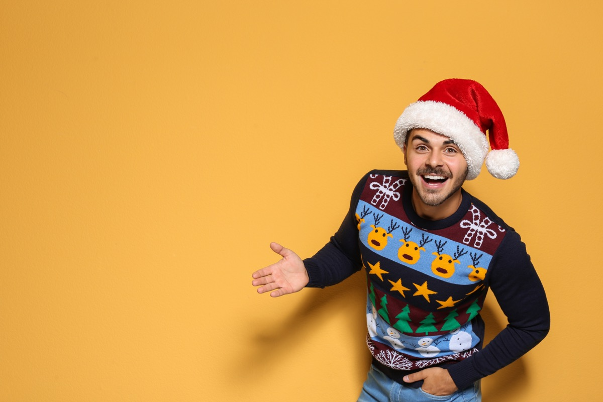 man wearing a santa hat and a christmas sweater