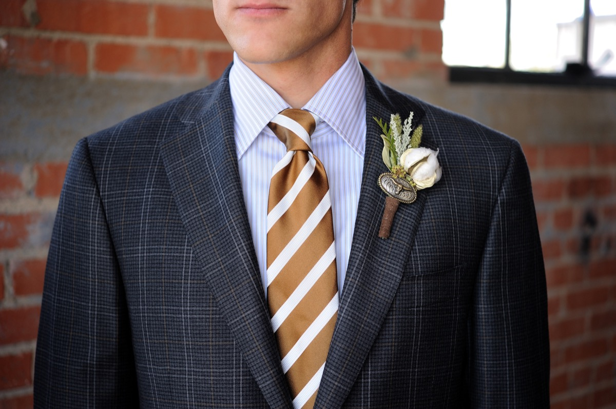 man wearing a striped tie and a plaid jacket