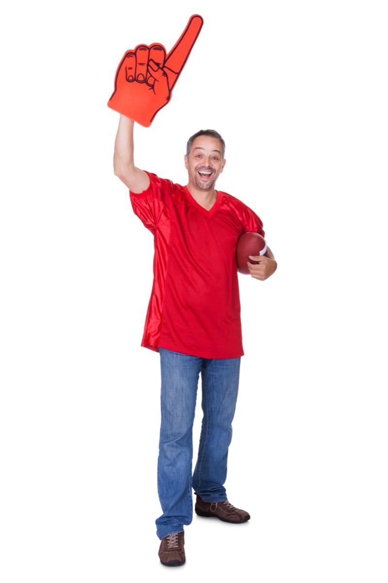 Man wearing a jersey holding a football