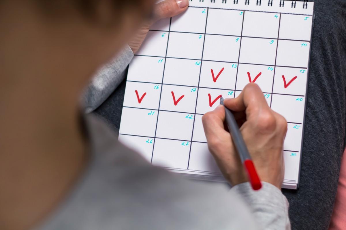 woman marking calendar