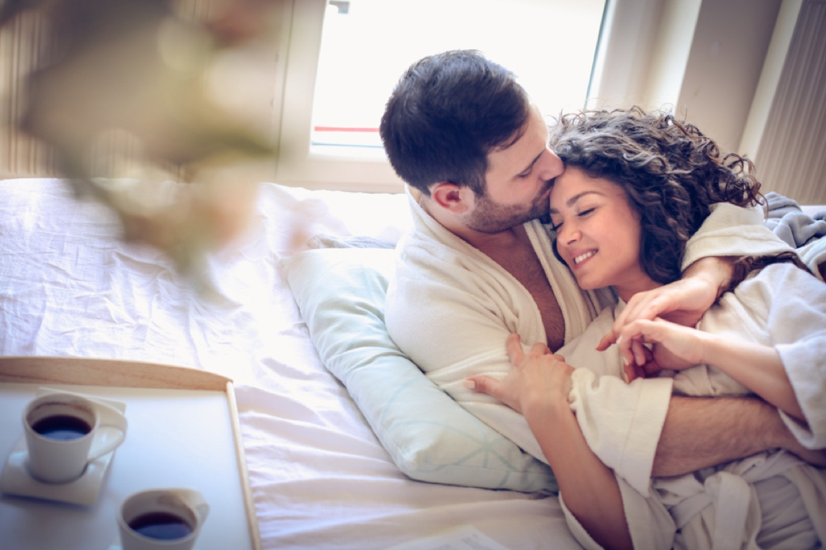 middle-aged couple in bed together, healthy sex after 40