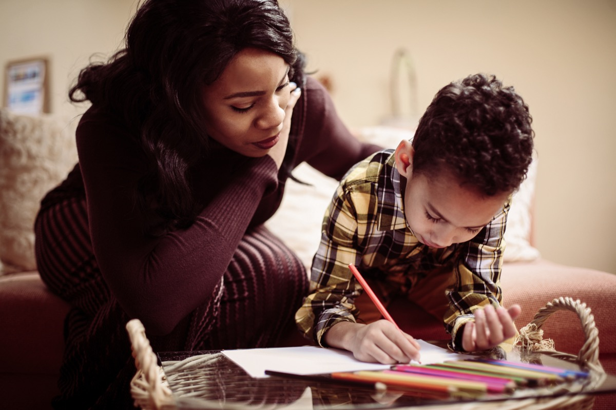 Mom doing homework with son