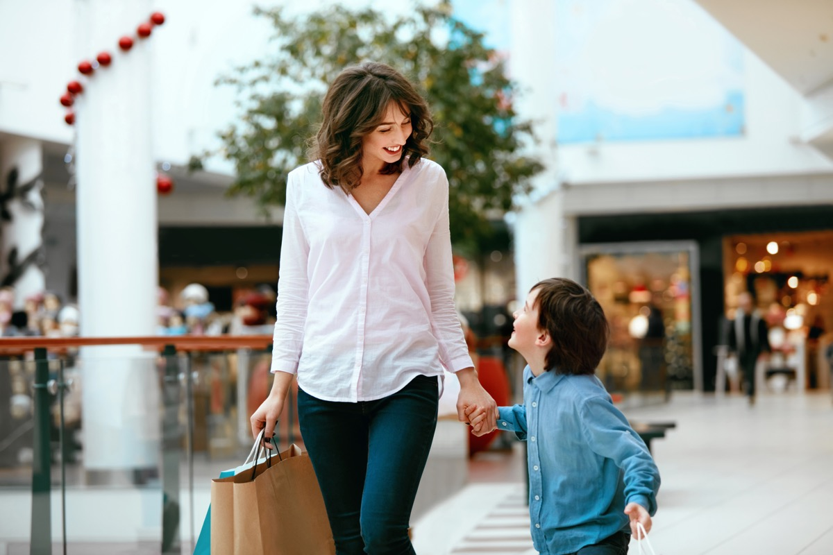 Mom shopping at the mall with her son