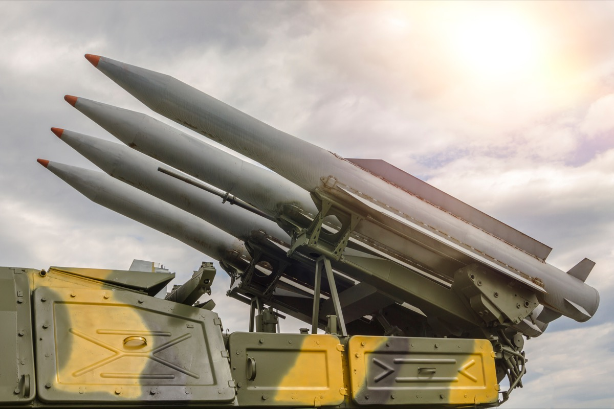 rocket set against a dramatic sky. four missiles ready for launch. Weapons of mass destruction, nuclear warhead