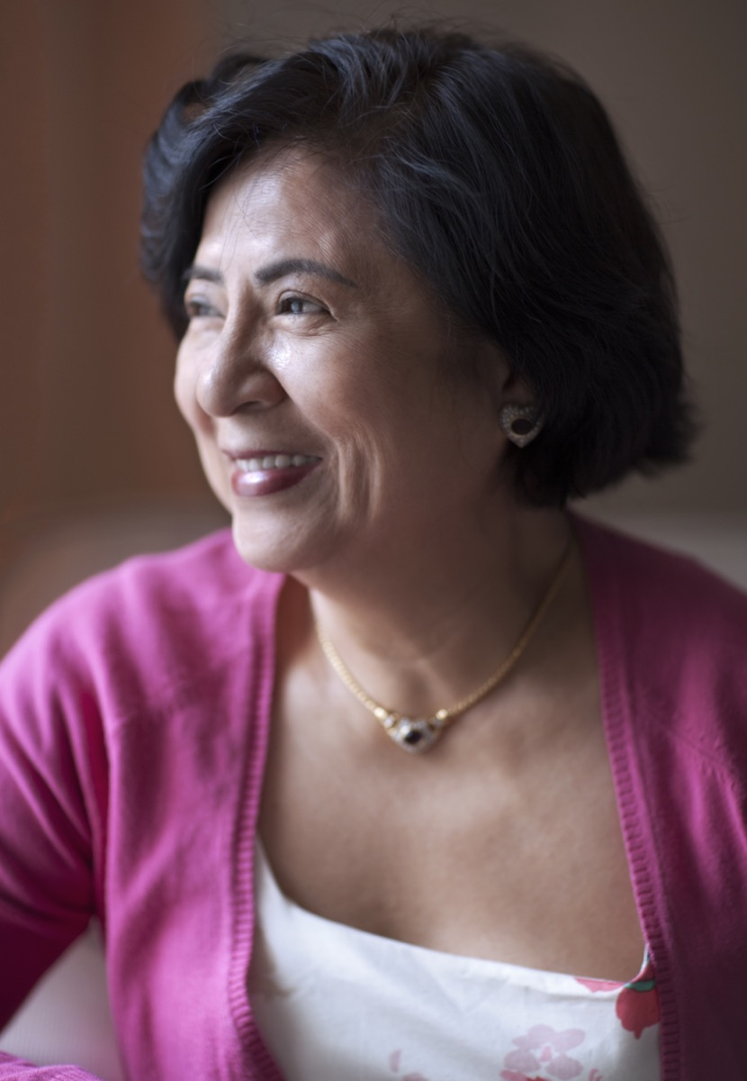 Older Asian woman wearing choker necklace
