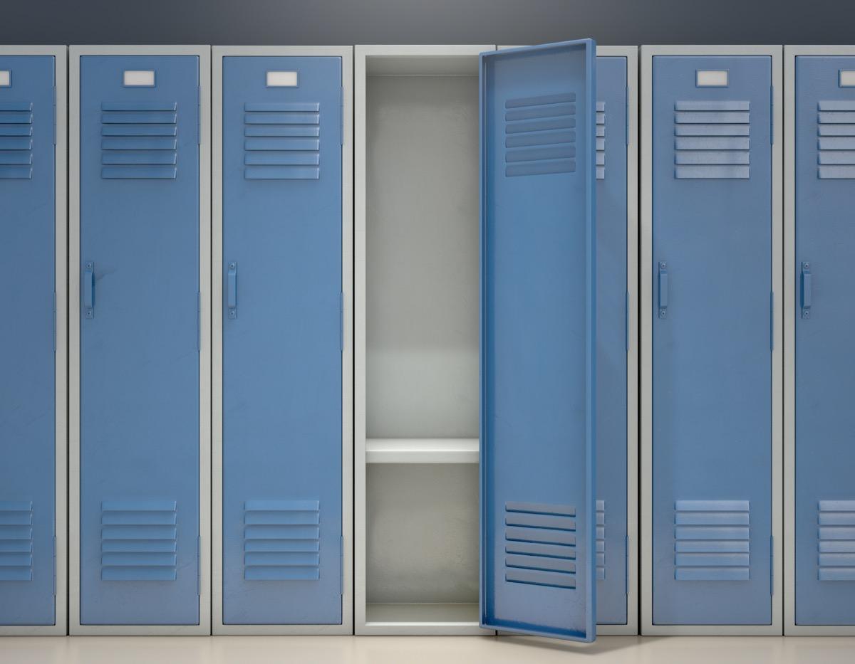 A row of blue metal school lockers with one open door revealing that it is empty